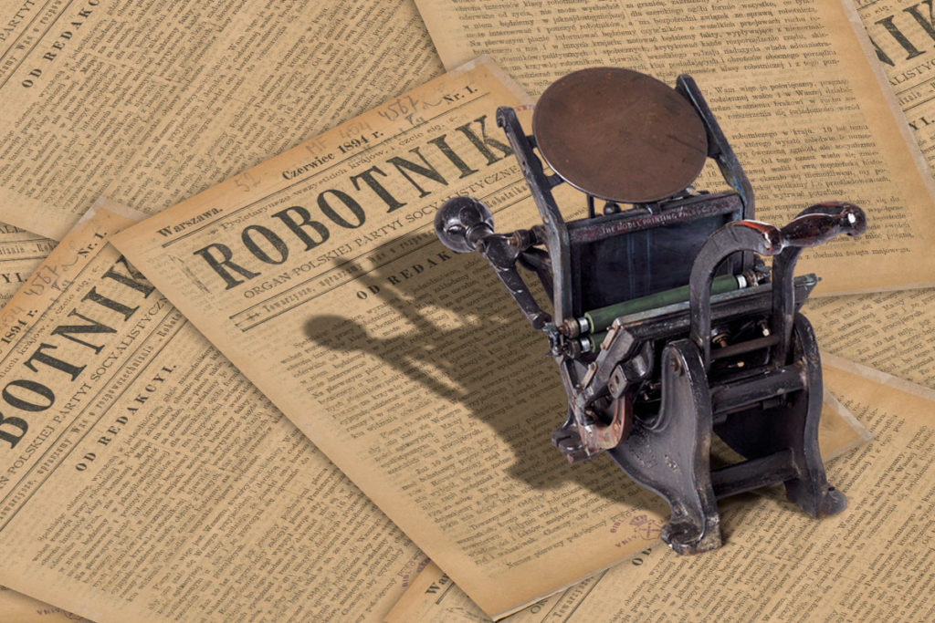 """maszyna drukarska bostonka na tle pierwszego numeru """"Robotnika"""""""